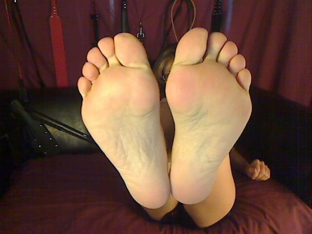 Stroke it to the soles of my sexy feet
