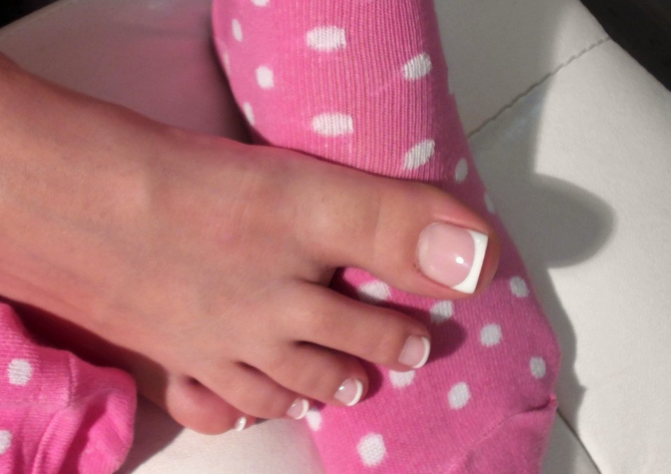 Pedicured toes for piggy's horny nose